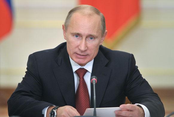 मास्को के एक प्रेस  कॉन्फ्रेंस में रूसी राष्ट्रपति ब्लादिमीर पुतिन।
