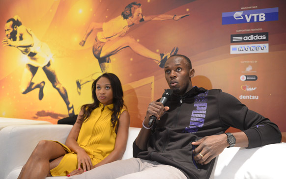बार्सिलोना में एक संवाददाता सम्मेलन को सम्बोधित करते जमैका के धावक उसैन बोल्ट और अमेरिकी एथलीट एलीसन फेलिक्स।