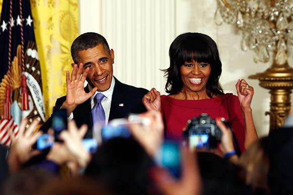 वाशिंगटन हाउस में अमेरिकी राष्ट्रपति बराक ओबामा और उनकी पत्नी मिशेल ओबामा।