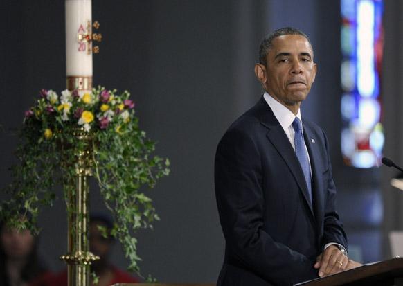 बोस्टन के कैथेड्रल आफ द हॉली क्रास में लोगों को संबोधित करते अमेरिकी राष्ट्रपति बराक ओबामा।