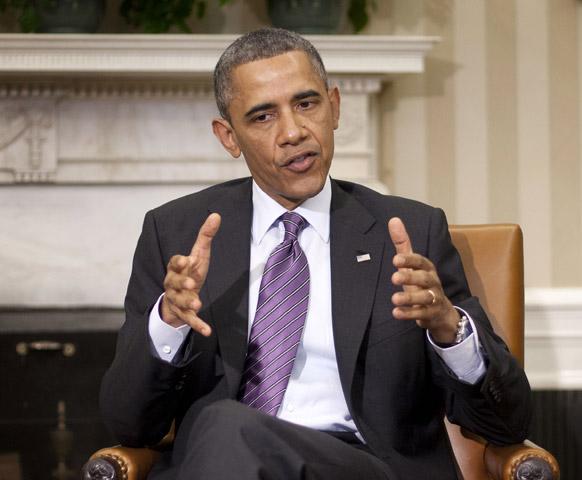 वाशिंगटन व्हाइट हाउस में सीरिया मुद्दे पर अमेरिकी राष्ट्रपति बराक ओबामा प्रश्नों का उत्तर देते हुए।