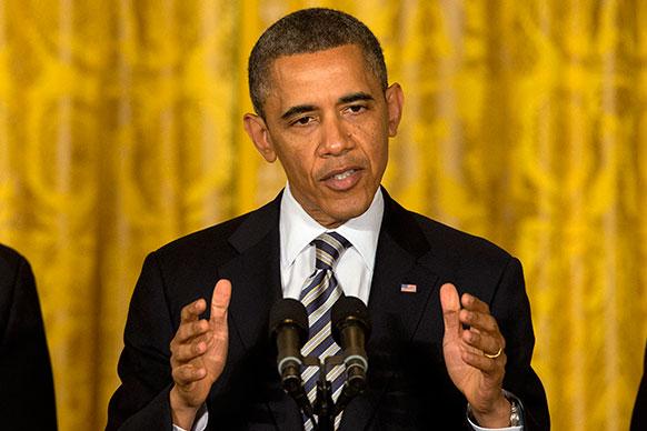वाशिंगटन हाउस में अमेरिकी राष्ट्रपति बराक ओबामा सदस्यों को संबोधित करते हुए।
