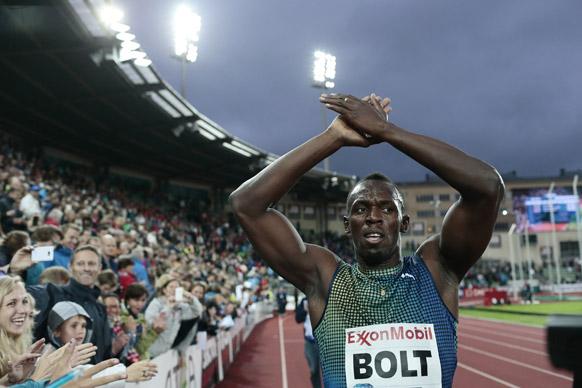 ओस्लो में पुरुषों के 200 मीटर दौड़ में रेस जीतने के बाद खुशी जाहिर करते जमाइका के धावक उसेन बोल्ट।