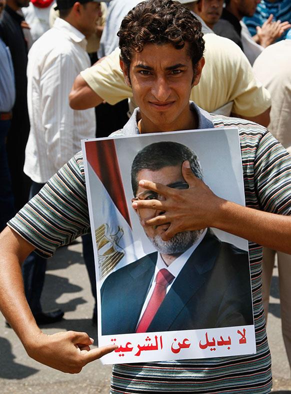 मिस्र में अपदस्थ राष्ट्रपति मोहम्मद मुर्सी के समर्थक।