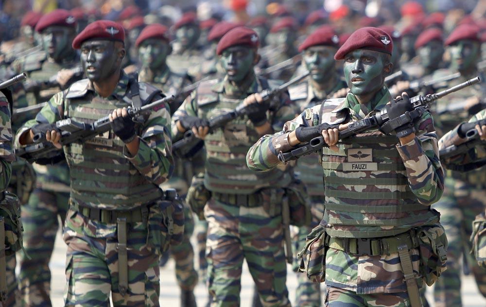 मलेशिया के कुआलालंपुर में 56वां नेशनल डे सेलिब्रेशन में हिस्सा लेते मलेशियन आर्मी फोर्स।