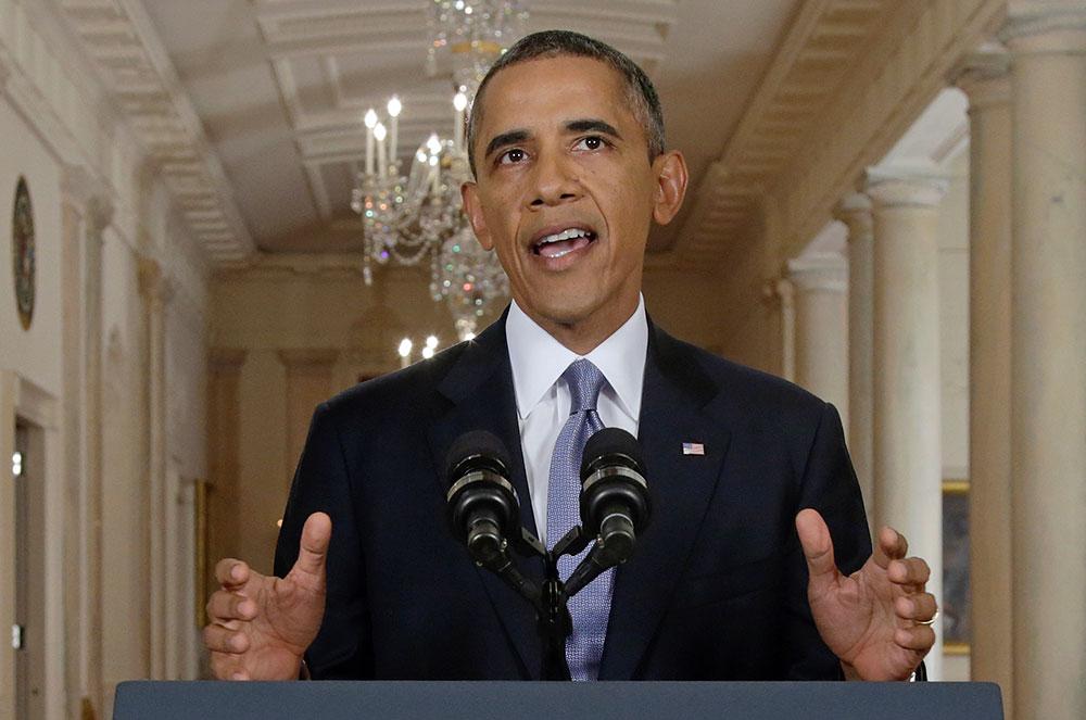 वाशिंगटन हाउस से टीवी पर जनता को संबोधित करते अमेरिकी राष्ट्रपति बराक ओबामा।