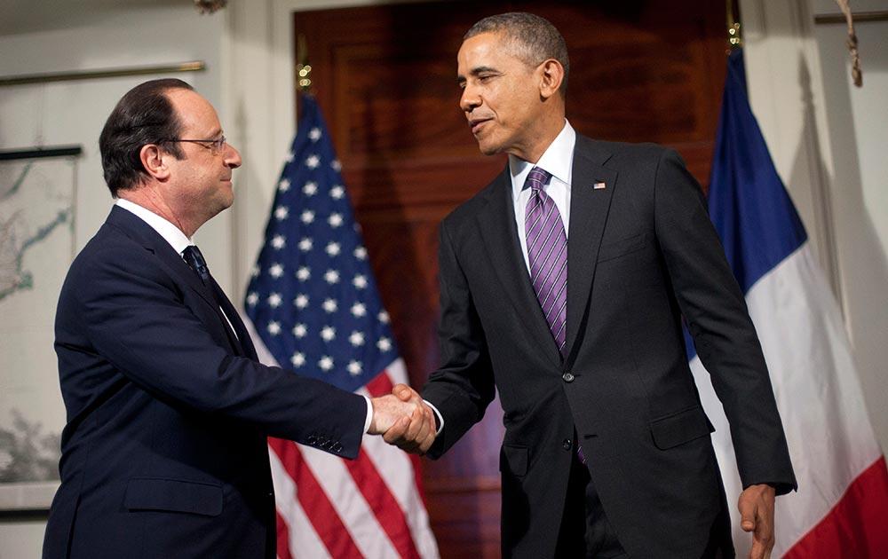 अमेरिकी राष्ट्रपति बराक ओबामा और फ्रांस के राष्ट्रपति फ्रांकोइस होलैंडो।