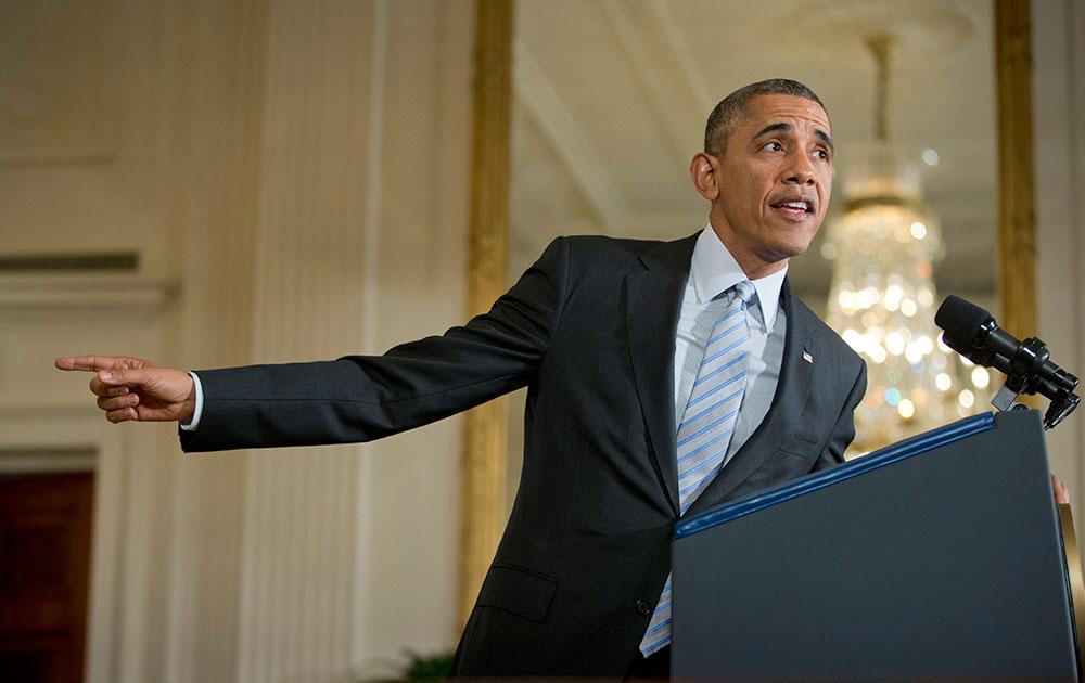 वाशिंगटन में व्हाइट हाउस को संबोधित करते अमेरिकी राष्ट्रपति बराक ओबामा।
