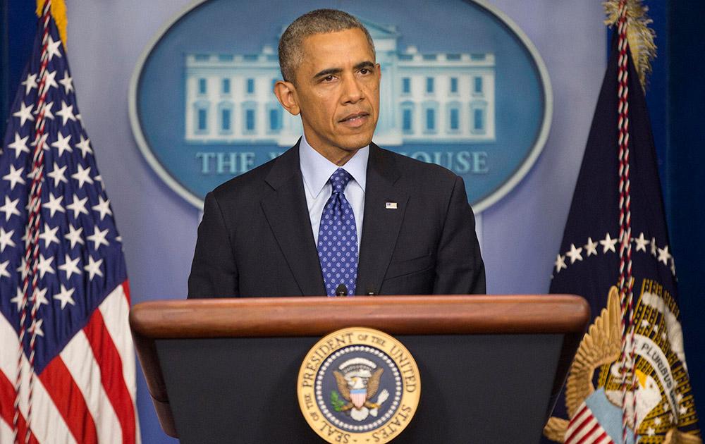 ह्वाइट हाउस में इराक संकट पर मीडिया को संबोधित करते अमेरिकी राष्ट्रपति बराक ओबामा।