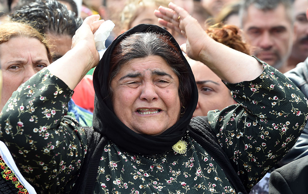 A woman shouts during a demonstration in Hannover, Germany. Thousands of people in Germany have protested against the persecution of the Yazidi minority in Iraq.
