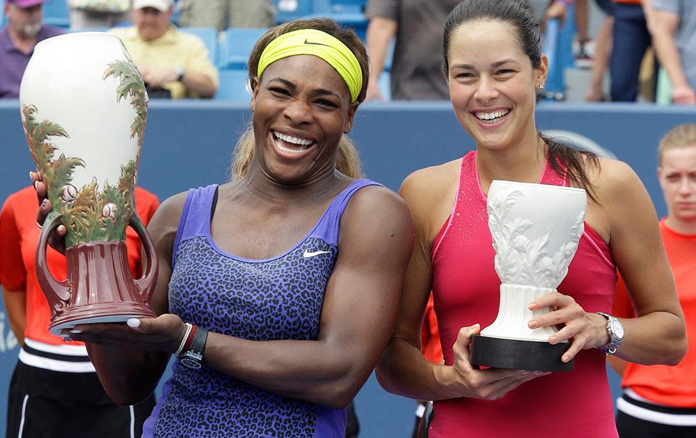 वेस्टर्न और साउदर्न ओपेन टेनिस टूर्नामेंट के तहत महिलाओं के फाइनल मैच में विजेता ट्राफी के साथ सेरेना विलियम्स और उप विेजेता ट्राफी के साथ सर्बिया की अना इवानोविक।