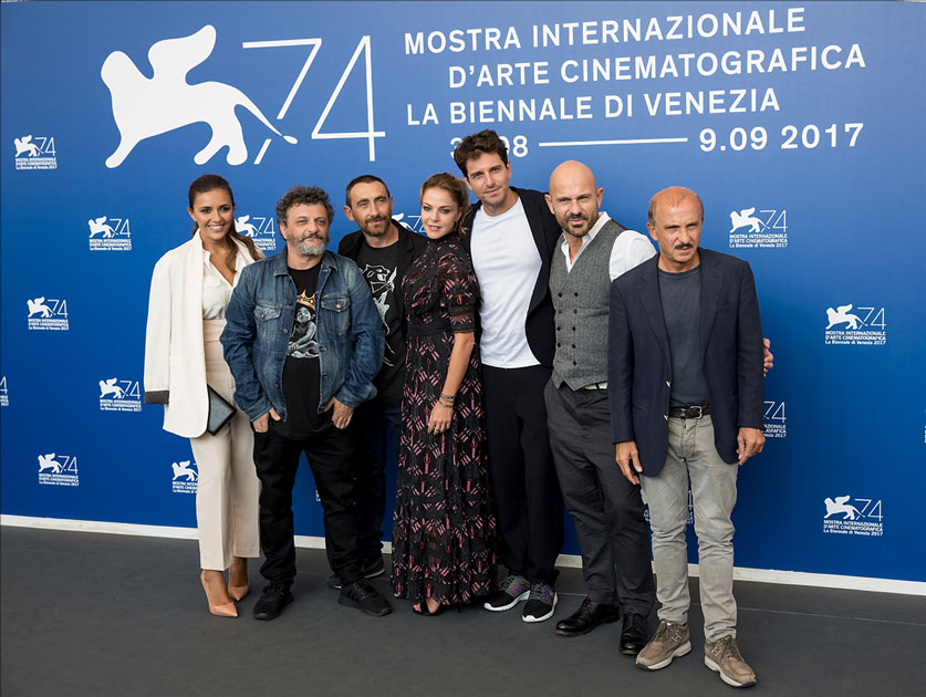 Cast members pose during a photocall