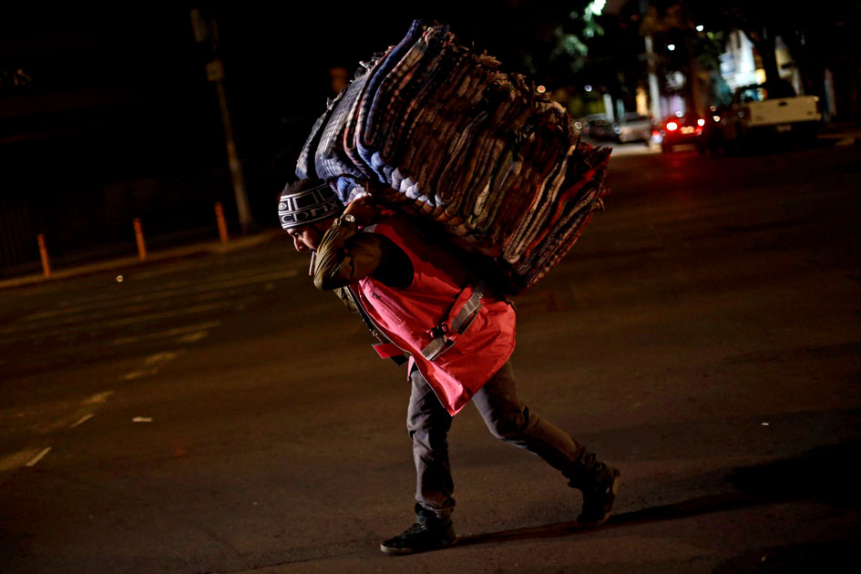 A volunteer carries blankets after an earthquake hit Mexico City