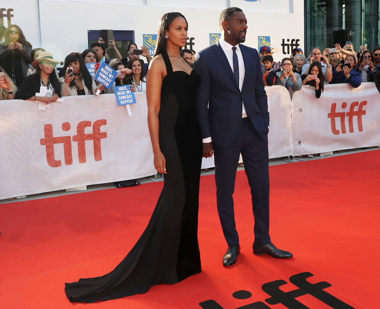 Actor Idris Elba arrives with his girlfriend Sabrina Dhowre at the premiere of the film