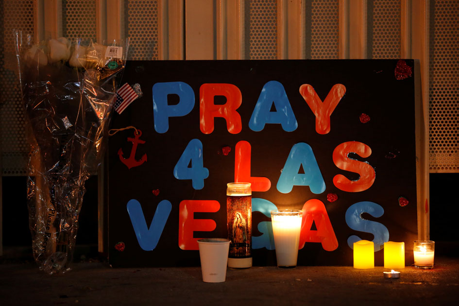 A sign is pictured at a vigil on the Las Vegas strip following a mass shooting at the Route 91 Harvest Country Music Festival in Las Vegas.