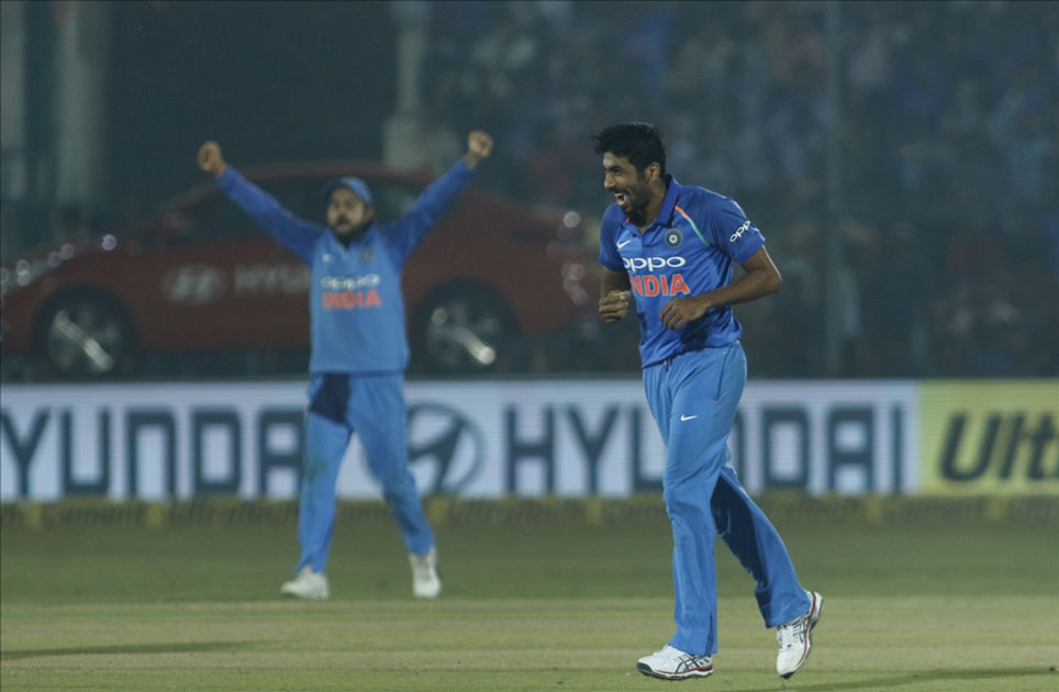 Jasprit Bumrah of India celebrates fall of Ross Taylor`s wicket during the third ODI match between India and New Zealand at Green Park Stadium in Kanpur.