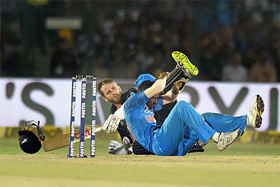 New Zealand batsman Kane Williamson and India`s Hardik Pandya falling after a collision during 3rd ODI cricket match against India at Green Park Stadium in Kanpur