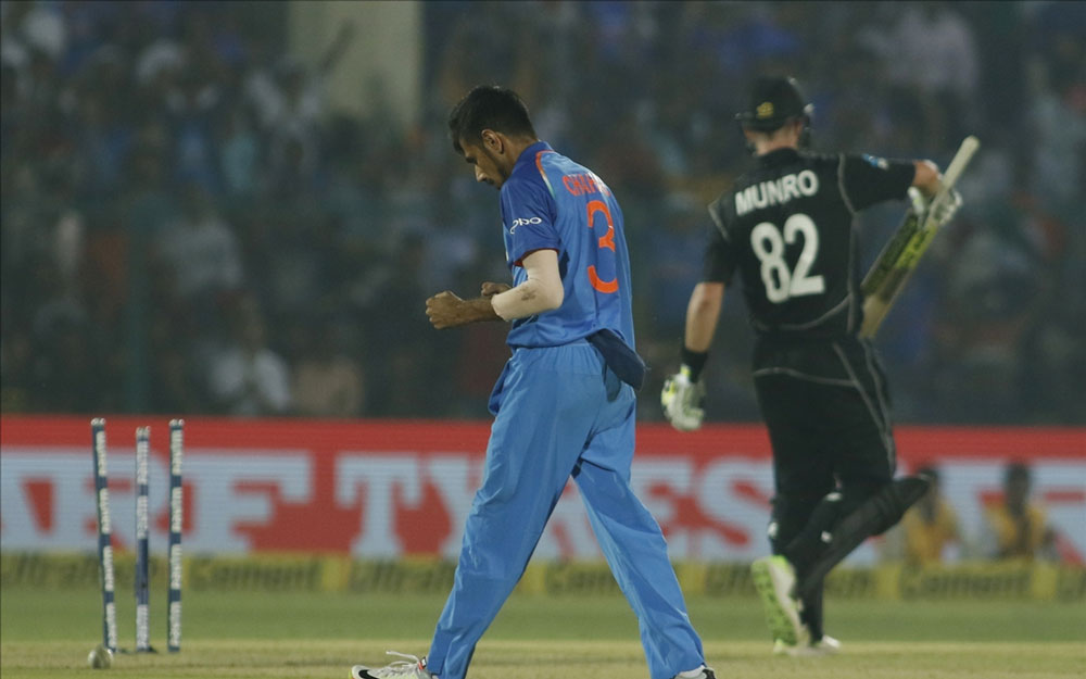 Yuzvendra Chahal of India celebrates fall of Colin Munro`s wicket during the third ODI match between India and New Zealand at Green Park Stadium in Kanpur.