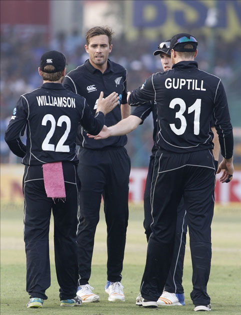 Tim Southee of New Zealand celebrates fall of Virat Kohli`s wicket during the third ODI match between India and New Zealand at Green Park Stadium in Kanpur.