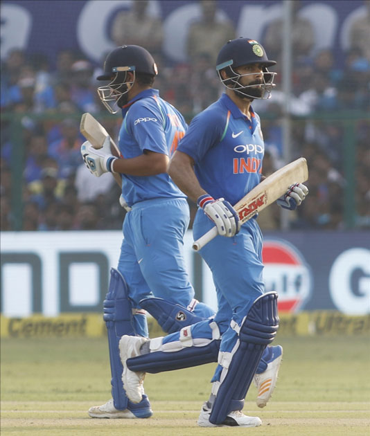Virat Kohli and Rohit Sharma of India celebrates his half century during the third ODI match between India and New Zealand at Green Park Stadium in Kanpur.