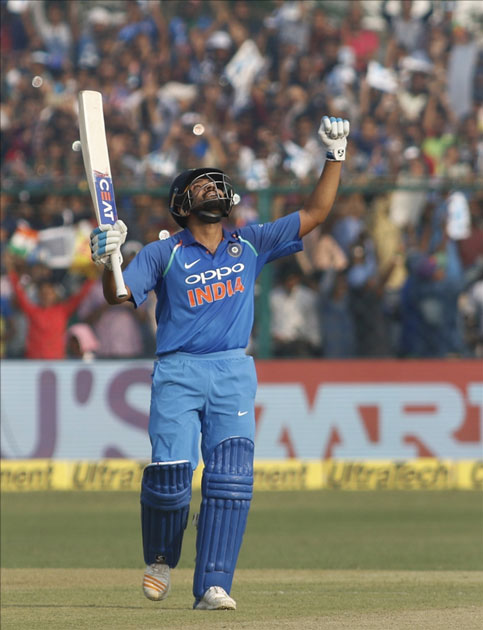 Rohit Sharma of India celebrates his century during the third ODI match between India and New Zealand at Green Park Stadium in Kanpur.