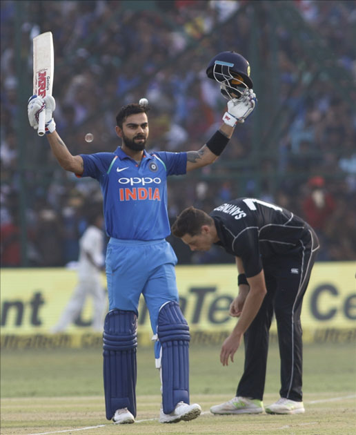 Virat Kohli of India celebrates his century during the third ODI match between India and New Zealand at Green Park Stadium in Kanpur.