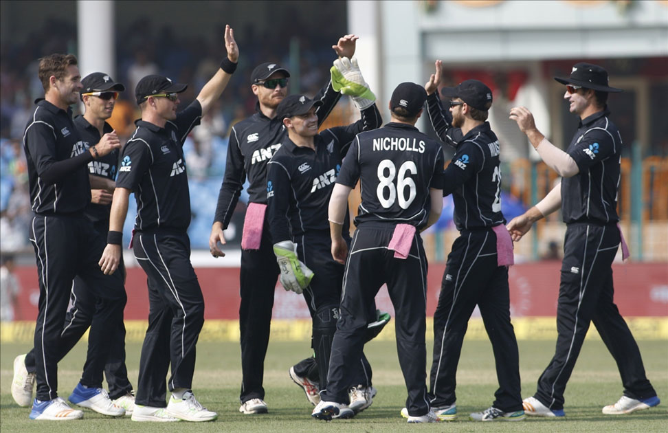 Tim Southee of New Zealand celebrates fall of Shikhar Dhawan`s wicket during the third ODI match between India and New Zealand at Green Park Stadium in Kanpur.
