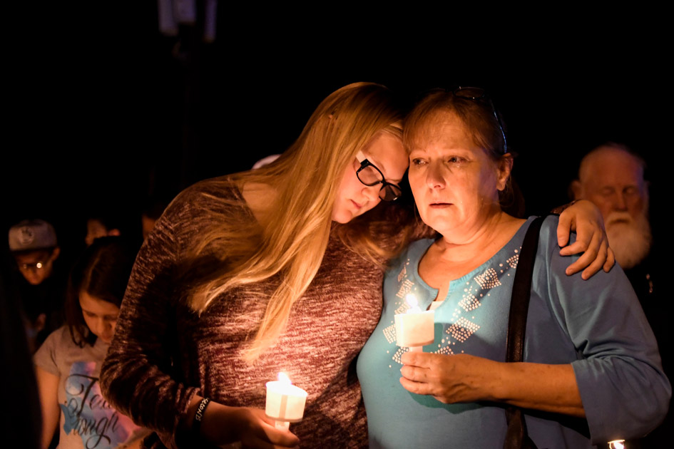 Local residents embrace during a candlelight vigil for victims of a mass shooting in a church in Sutherland Springs, Texas.