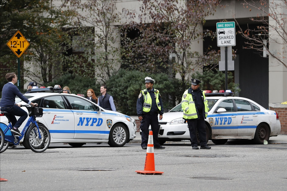 Policemen stand guard during the New York City Marathon in Manhattan of New York, the United States.