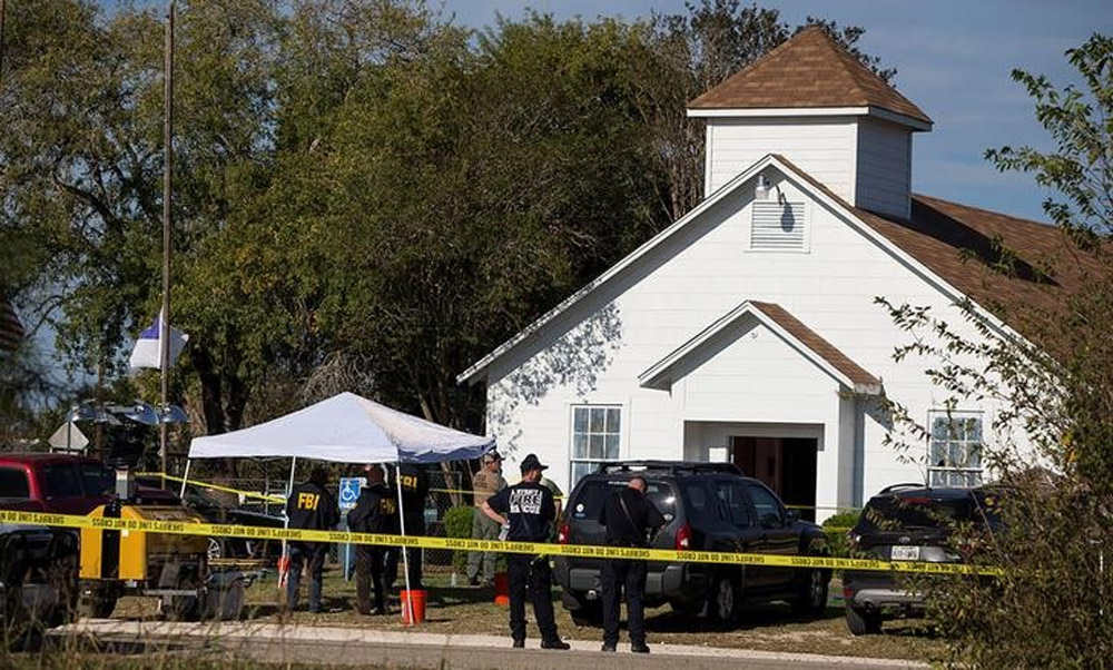 Law enforcement officials investigate a mass shooting at the First Baptist Church in Sutherland Springs.