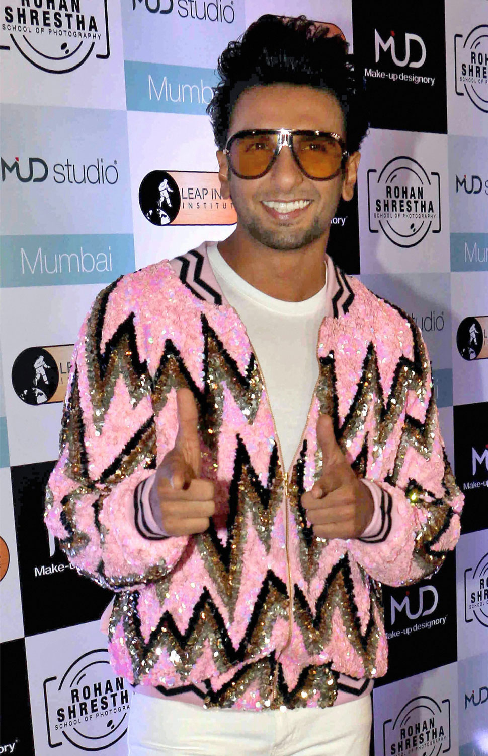 ranveer singh blingy jacket and kriti sanons latest fashion shows at an event
