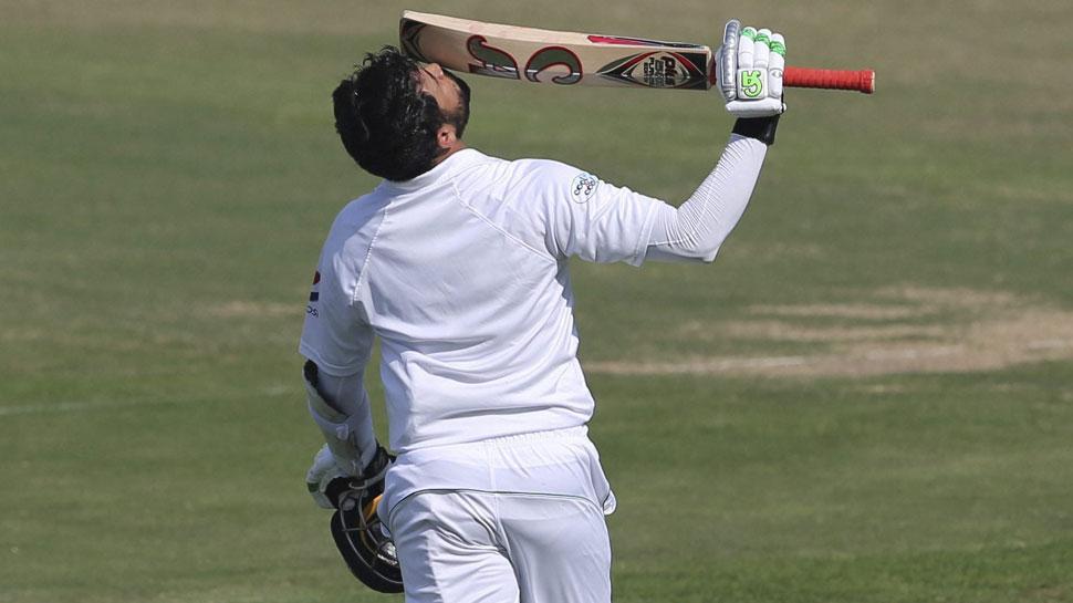 Azhar Ali kisses his bat