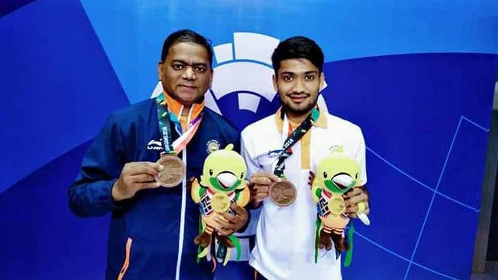 Harish Kumar with coach hemraj