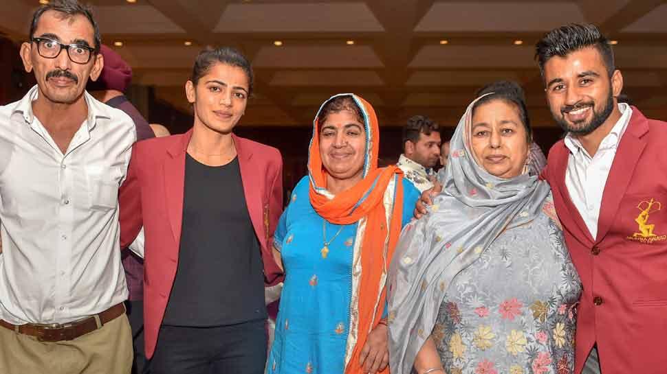 Savita Punia, Manpreet Singh  PTI