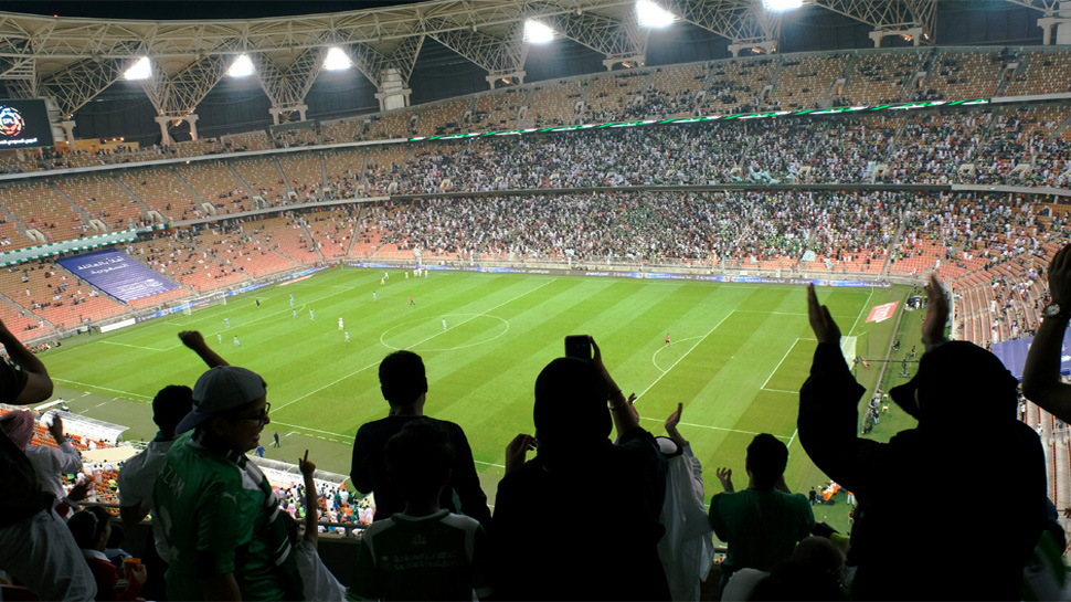 Saudi women cheer during a soccer match between Al-Ahli and Al-Batin at the King Abdullah Sports City in Jeddah