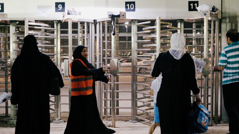 Saudi women arrive to watch the soccer match between Al-Ahli against Al-Batin at the King Abdullah Sports City in Jeddah