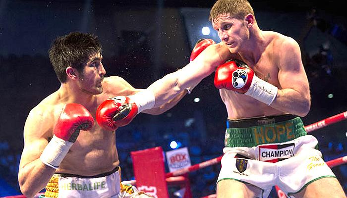 भारतीय मुक्केबाज विजेंदर ने भारत में आमिर खान से भिड़ने के संकेत दिये