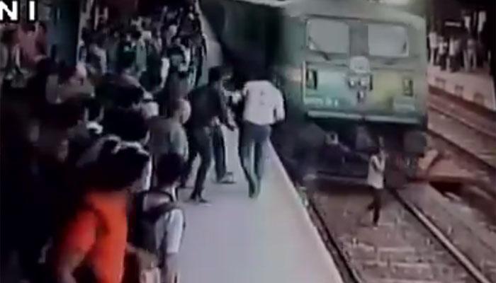 VIDEO, फोन पर बात करते हुए ट्रेन के नीचे आई लड़की, बच गई जान