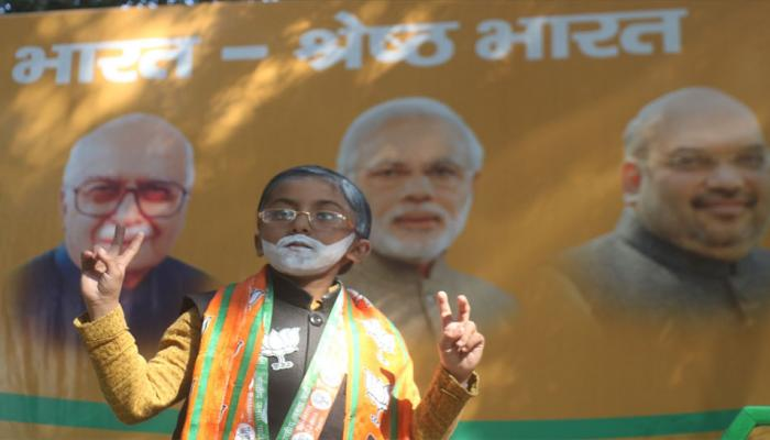 A young BJP supporter during celebrations after the winning the Gujarat assembly elections