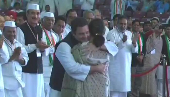 Sonia Gandhi hugs Rahul Gandhi after completing her speech at Congress Plenary Session