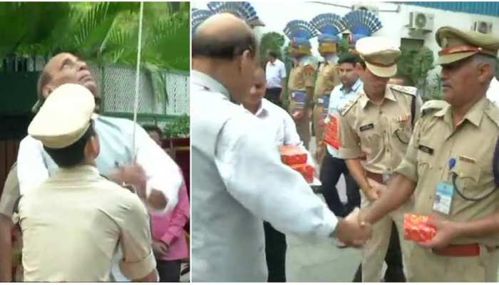 Union Home Minister Rajnath Singh hoists the Tiranga at his residence on Independence Day of India