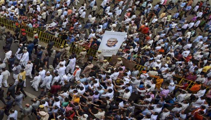 public participate in the last journey of former prime minister Atal Bihari Vajpayee as his mortal remains are taken for cremation to Smriti Sthal, in New Delhi