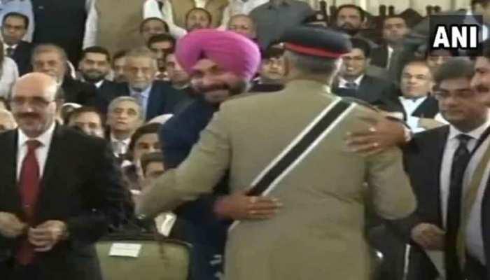 Sidhu hug Pakistan Army Chief General Qamar Javed Bajwa and seated next to Pok president at Imran Khan's oath ceremony