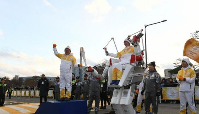 robot run with the Winter Olympic torch